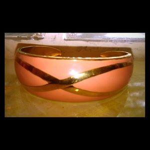 Peach colored gold bracelet